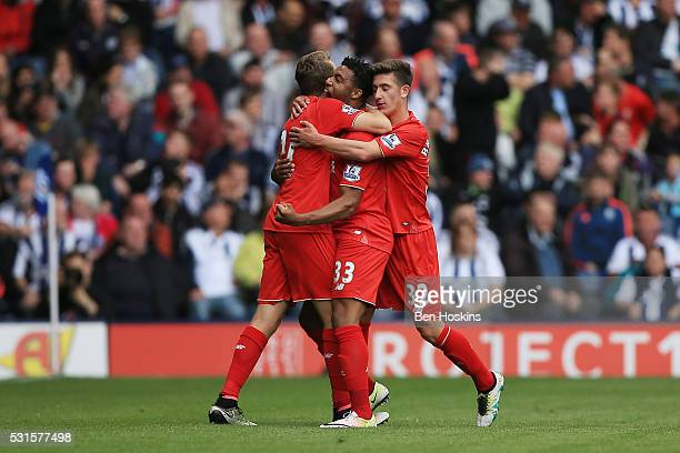Jordon Ibe of Liverpool celebrates scoring his team's first goal with his team mates during the Barclays Premier League match between West Bromwich...