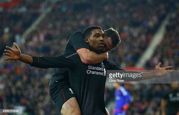 Jordon Ibe of Liverpool celebrates with Connor Randall as he scores their fifth goal during the Capital One Cup quarter final match between...