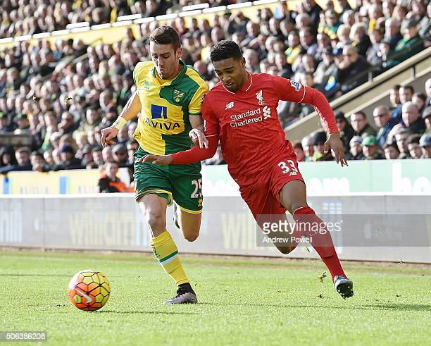 Jordon Ibe of Liverpool competes with Ivo Pinto of Norwich City during the Barclays Premier League match between Norwich City and Liverpool at Carrow...