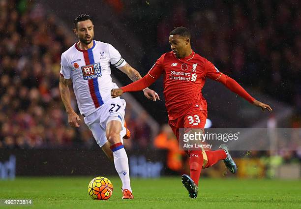 Jordon Ibe of Liverpool holds off Damien Delaney of Crystal Palace during the Barclays Premier League match between Liverpool and Crystal Palace at...