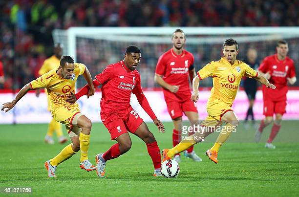 Jordon Ibe of Liverpool is challenged by Tarek Elrich of United during the international friendly match between Adelaide United and Liverpool FC at...