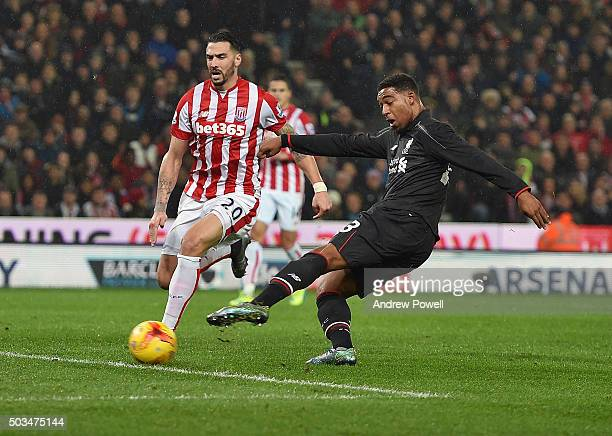 Jordon Ibe of Liverpool scores the opening goal during the Capital One Cup semi final first leg match between Stoke City and Liverpool at Britannia...