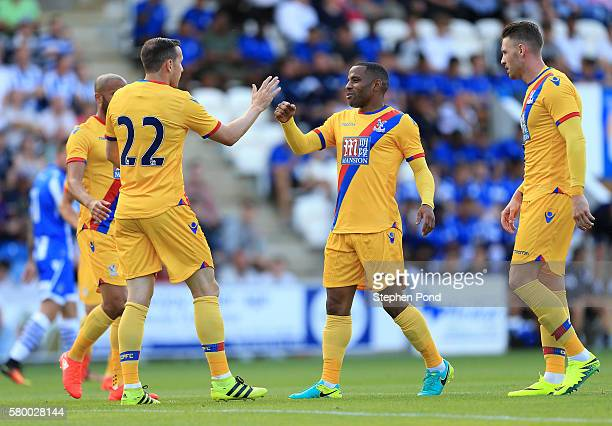 Jordon Mutch of Crystal Palace celebrates his opening goal with Jason Puncheon during the PreSeason Friendly match between Colchester United and...