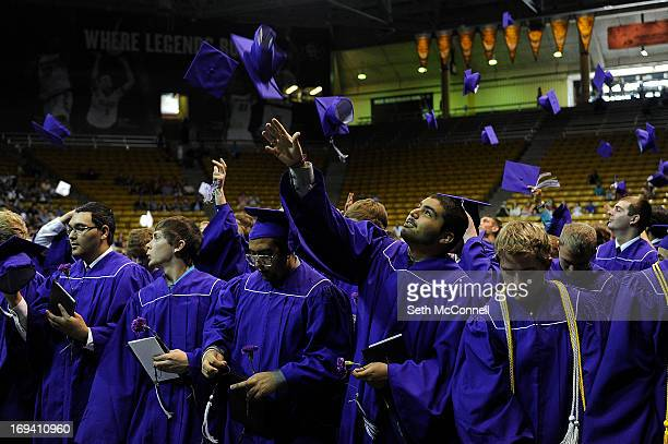 Jordy Arellano tosses his cap in the air following Arvada West High Schools graduation ceremony at the Coors Events Center on the Campus of the...