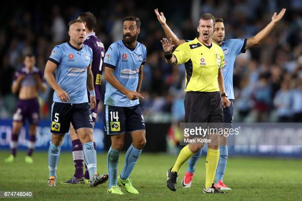 Jordy Buijs Alex Brosque and Bobo of Sydney FC react as referee Peter Green calls for calm during the ALeague Semi Final match between Sydney FC and...