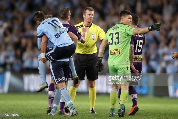 Jordy Buijs and Milos Ninkovic of Sydney FC celebrate as Lucian Goian Liam Reddy and Josh Risdon of the Glory argue with referee Peter Green after a...