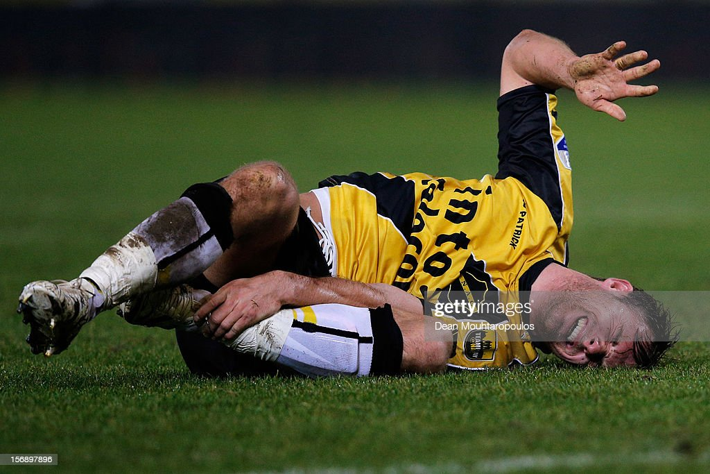 Jordy Buijs of NAC reatcs to a tackle by holding his ankle during the Eredivisie match between NAC Breda and ADO Den Haag at the Rat Verlegh Stadium on November 23, 2012 in Breda, Netherlands.