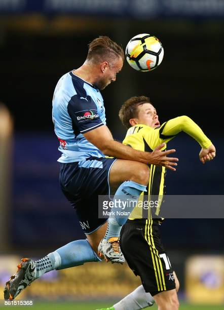 Jordy Buijs of Sydney and Michael McGlinchey of Wellington contest possession during the round two ALeague match between Sydney FC and the Wellington...