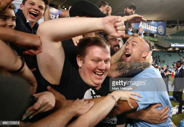 Jordy Buijs of Sydney FC celebrates with fans after winning the 2017 ALeague Grand Final match between Sydney FC and the Melbourne Victory at Allianz...