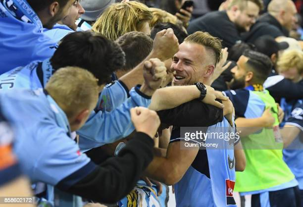 Jordy Buijs of Sydney FC celebrates with fans after winning the round one ALeague match between the Melbourne Victory and Sydney FC at Etihad Stadium...
