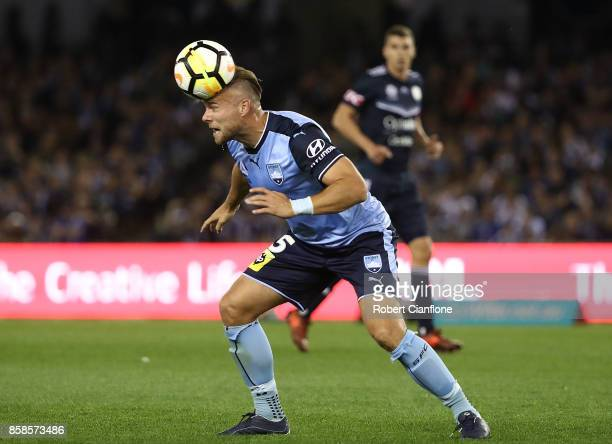 Jordy Buijs of Sydney FC heads the ball during the round one ALeague match between the Melbourne Victory and Sydney FC at Etihad Stadium on October 7...