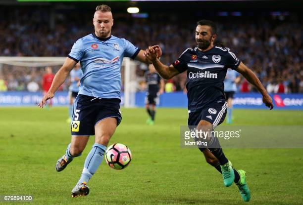 Jordy Buijs of Sydney FC is challenged by Fahid Ben Khalfallah of Melbourne Victory during the 2017 ALeague Grand Final match between Sydney FC and...