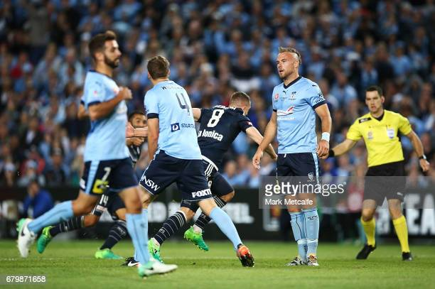 Jordy Buijs of Sydney FC looks dejected as Besart Berisha of the Victory celebrates scoring a goal during the 2017 ALeague Grand Final match between...
