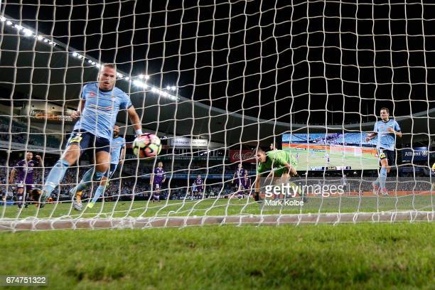 Jordy Buijs of Sydney FC scores a goal as Liam Reddy of the Glory watches on during the ALeague Semi Final match between Sydney FC and the Perth...