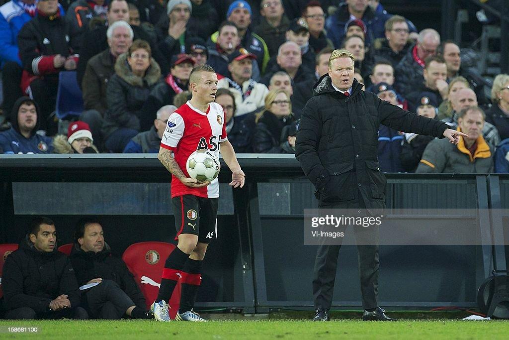 Jordy Clasie of Feyenoord, coach Ronald Koeman of Feyenoord during the Dutch Eredivise match between Feyenoord and FC Groningen at stadium De Kuip on December 23, 2012 in Rotterdam, The Netherlands.