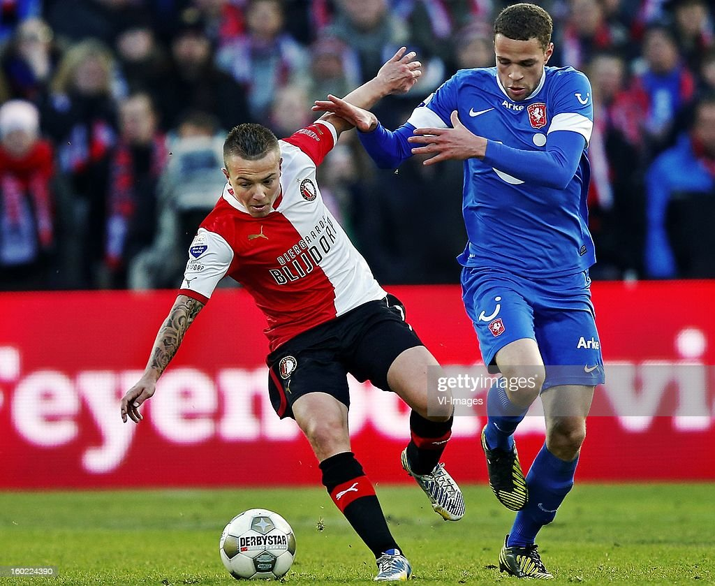 Jordy Clasie of Feyenoord (L), Luc Castaignos of FC Twente (R) during the Dutch Eredivise match between Feyenoord and FC Twente at stadium De Kuip on January 27, 2013 in Rotterdam, The Netherlands.