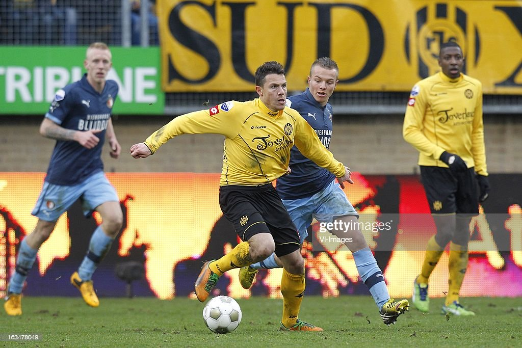 Jordy Clasie of Feyenoord (R), Mark-Jan Fledderus of Roda JC (L) during the Dutch Eredivisie match between Roda JC Kerkrade and Feyenoord at the Parkstad Limburg on march 10, 2013 in Kerkrade, The Netherlands