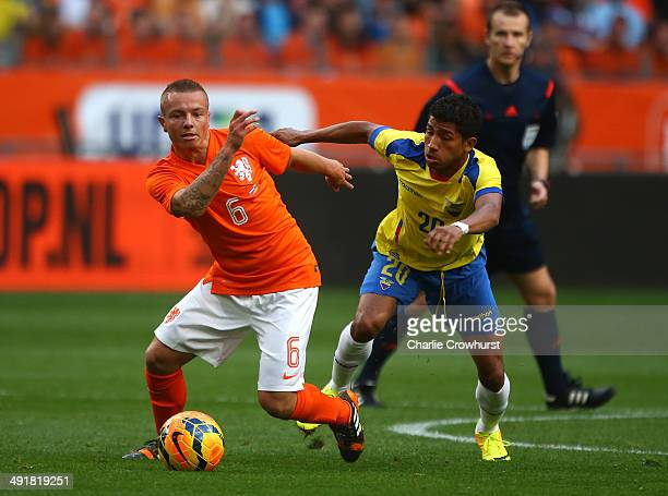 Jordy Clasie of Holland looks to hold of Ecuador's Joao Rojas during the International Friendly match between The Netherlands and Ecuador at The...