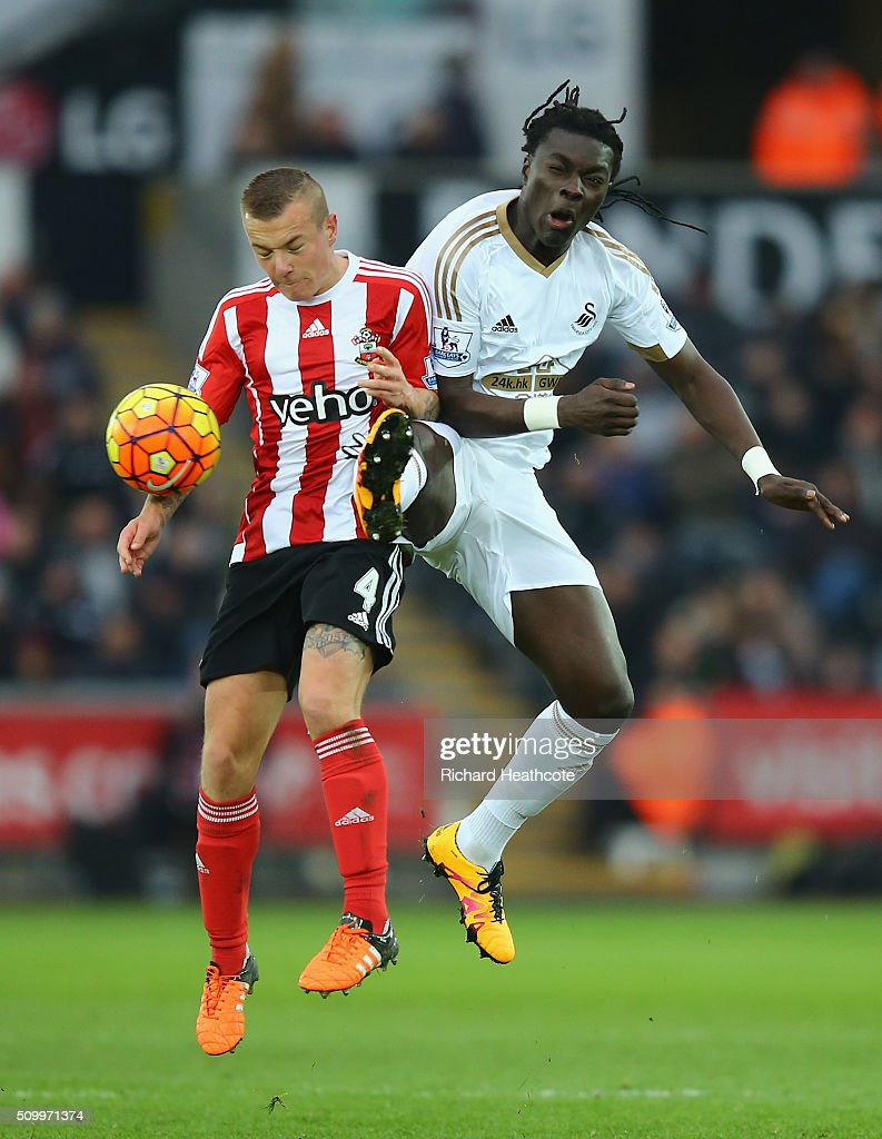 <a gi-track='captionPersonalityLinkClicked' href=/galleries/search?phrase=Jordy+Clasie&family=editorial&specificpeople=7012011 ng-click='$event.stopPropagation()'>Jordy Clasie</a> of Southampton and Bafetimbi Gomis of Swansea City compete for the ball during the Barclays Premier League match between Swansea City and Southampton at Liberty Stadium on February 13, 2016 in Swansea, Wales.