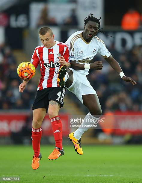 Jordy Clasie of Southampton and Bafetimbi Gomis of Swansea City compete for the ball during the Barclays Premier League match between Swansea City...