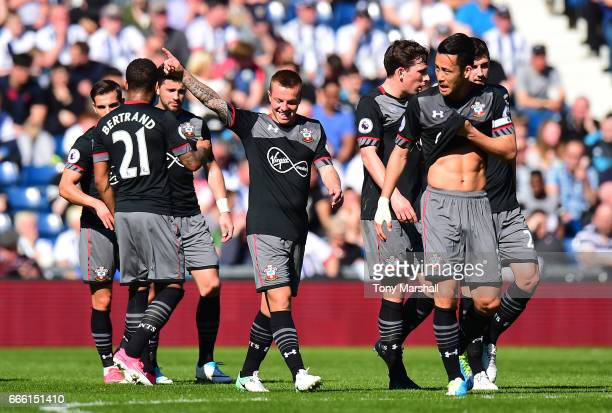 Jordy Clasie of Southampton celebrates scoring his sides first goal with his Southampton team mates during the Premier League match between West...