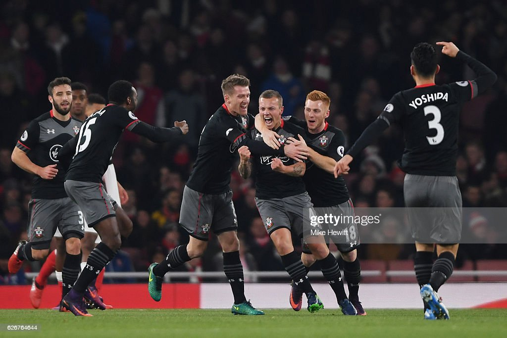 Jordy Clasie of Southampton celebrates with team mates after scoring the opening goal of the game during the EFL Cup quarter final match between Arsenal and Southampton at the Emirates Stadium on November 30, 2016 in London, England.