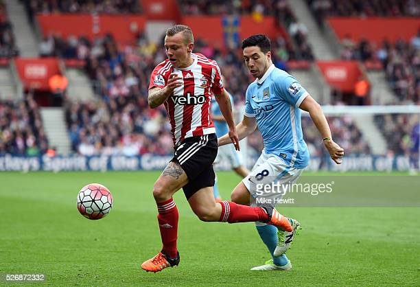 Jordy Clasie of Southampton evades Samir Nasri of Manchester City during the Barclays Premier League match between Southampton and Manchester City at...