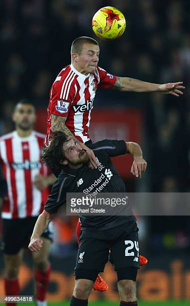 Jordy Clasie of Southampton outjumps Joe Allen of Liverpool during the Capital One Cup quarter final match between Southampton and Liverpool at St...