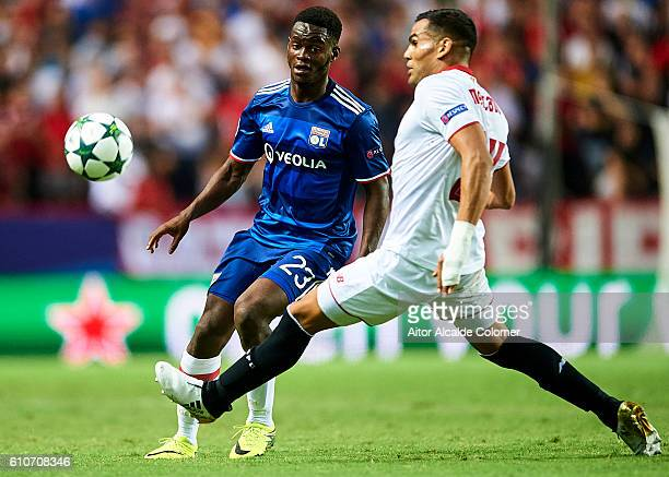 Jordy Gaspar of Olympique Lyonnais competes for the ball with Gabriel Mercado of Sevilla FC during the UEFA Champions League match between Sevilla FC...