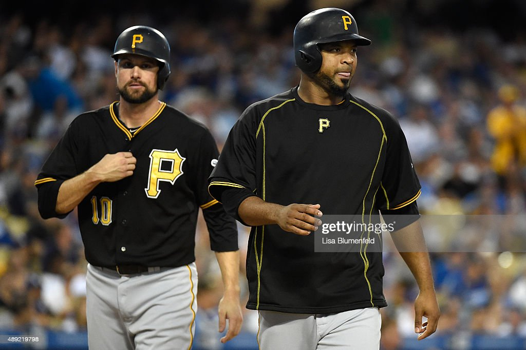 Jordy Mercer #10 and Francisco Liriano #47 of the Pittsburgh Pirates score in the third inning against the Los Angeles Dodgers at Dodger Stadium on September 19, 2015 in Los Angeles, California.