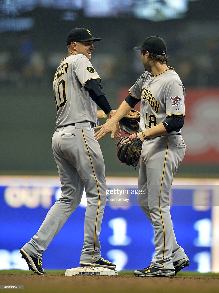 Jordy Mercer #10 (L) and Neil Walker #18 of the Pittsburgh Pirates celebrate their win over the Milwaukee Brewers at Miller Park on August 22, 2014 in Milwaukee, Wisconsin. The Pirates defeated the Brewers 8-3.