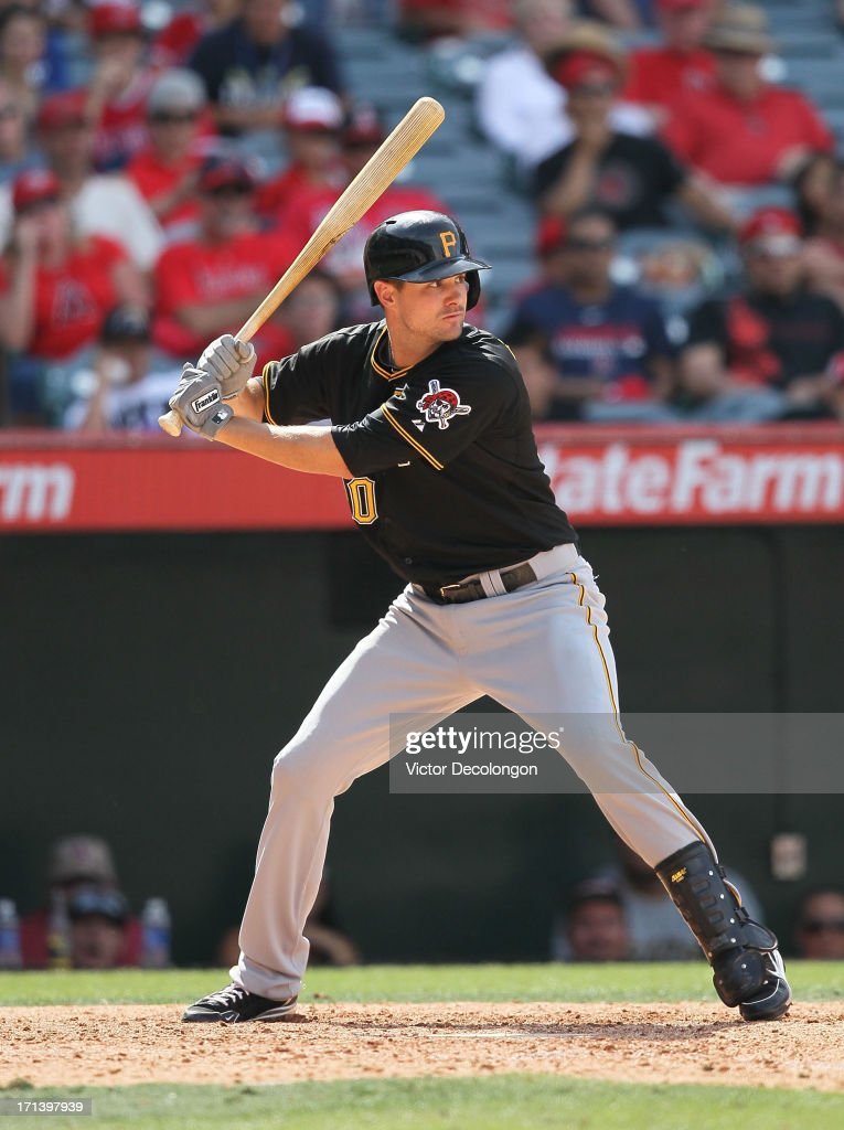 Jordy Mercer #10 of the Pittsburgh Pirates bats in the tenth inning during the MLB game against the Los Angeles Angels of Anaheim at Angel Stadium of Anaheim on June 23, 2013 in Anaheim, California. The Pirates defeated the Angels 10-9 in ten innings.