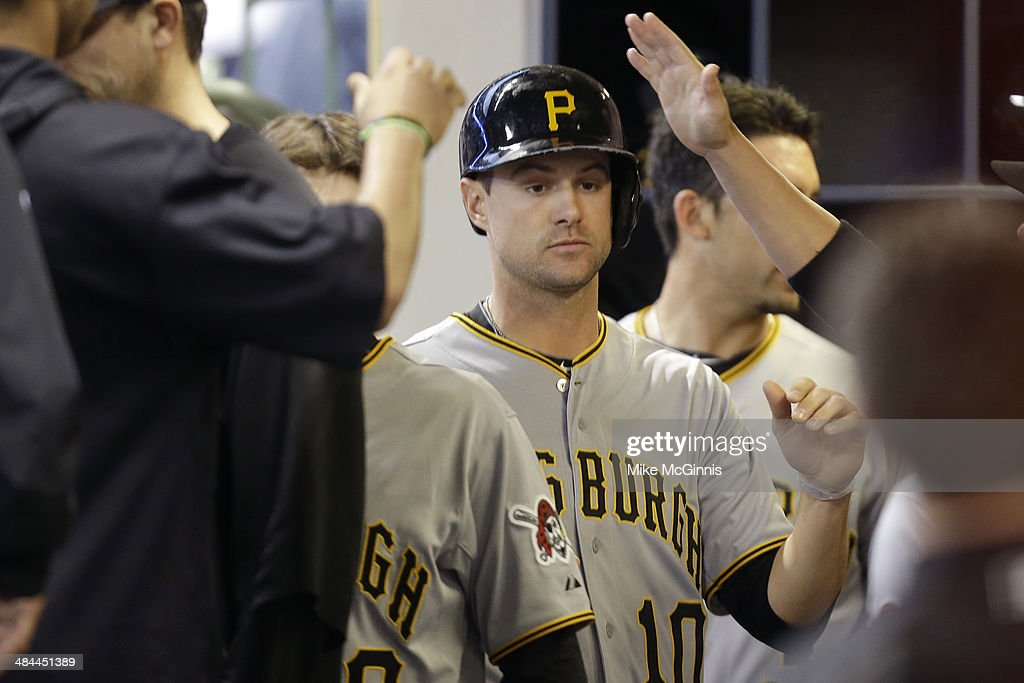 Jordy Mercer #10 of the Pittsburgh Pirates celebrates in the dugout after reaching on a single hit by Travis Snider in the top of the third inning against the Milwaukee Brewers at Miller Park on April 12, 2014 in Milwaukee, Wisconsin.