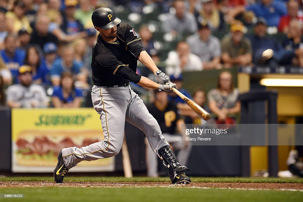 Jordy Mercer of the Pittsburgh Pirates hits a grand slam home run during the sixth inning of a game against the Milwaukee Brewers at Miller Park on...