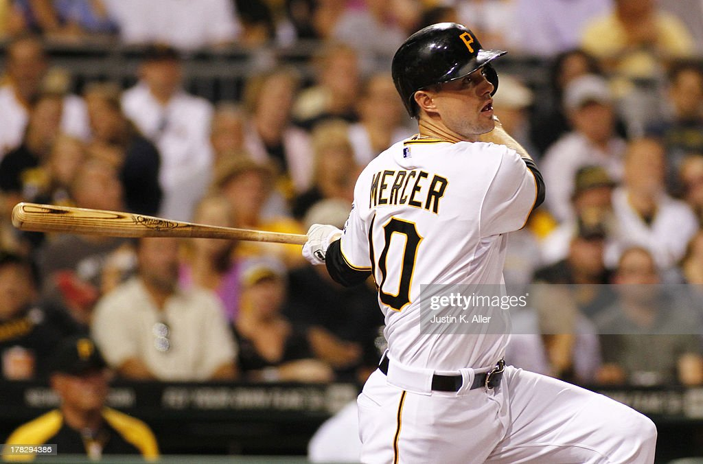 Jordy Mercer #10 of the Pittsburgh Pirates hits an RBI double in the fifth inning against the Milwaukee Brewers during the game on August 28, 2013 at PNC Park in Pittsburgh, Pennsylvania.