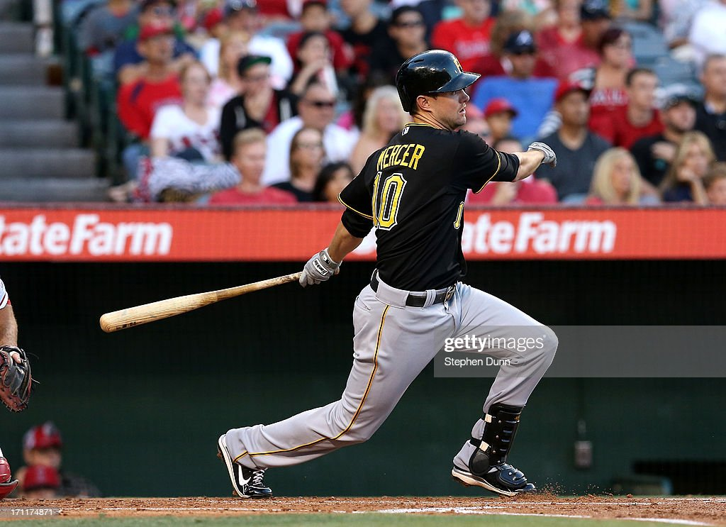 Jordy Mercer #10 of the Pittsburgh Pirates hits an RBI single in the second inning against the Los Angeles Angels of Anaheim at Angel Stadium of Anaheim on June 22, 2013 in Anaheim, California.