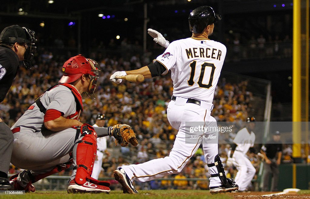 Jordy Mercer #10 of the Pittsburgh Pirates hits an RBI single in the fifth inning against the St. Louis Cardinals during game two of a doubleheader on July 30, 2013 at PNC Park in Pittsburgh, Pennsylvania.