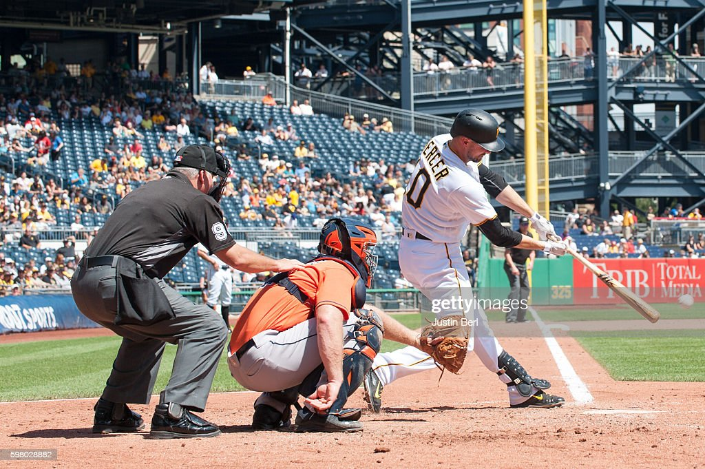Jordy Mercer of the Pittsburgh Pirates in action during the game against Evan Gattis of the Houston Astros at PNC Park on August 24 2016 in...