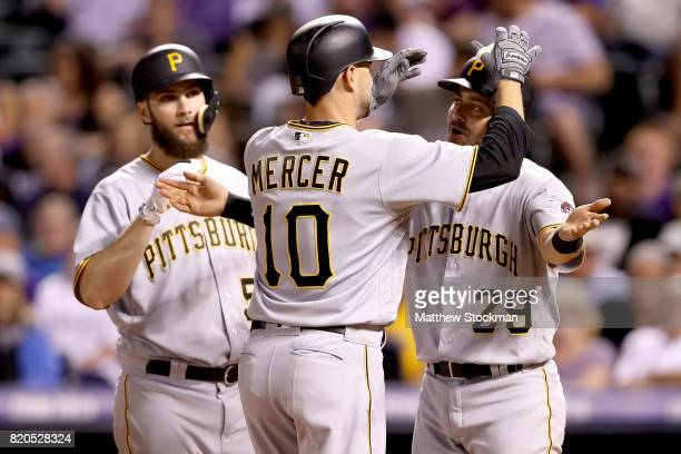 Jordy Mercer of the Pittsburgh Pirates is congratulated by Trevor Williams and Francisco Cervelli after hitting a 2 RBI home run in the sixth inning...