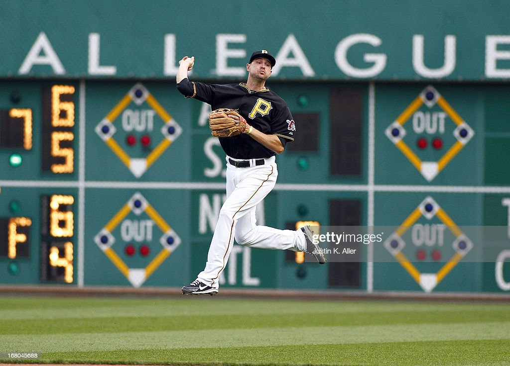 Jordy Mercer #10 of the Pittsburgh Pirates makes a play on a ball deep in the hole against the Washington Nationals during the game on May 4, 2013 at PNC Park in Pittsburgh, Pennsylvania. The Nationals defeated the Pirates 5-4.