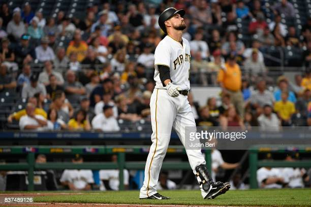 Jordy Mercer of the Pittsburgh Pirates reacts after being called out on strikes in the second inning during the game against the Los Angeles Dodgers...