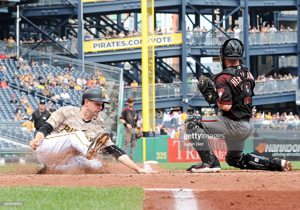 <a gi-track='captionPersonalityLinkClicked' href=/galleries/search?phrase=Jordy+Mercer&family=editorial&specificpeople=4412527 ng-click='$event.stopPropagation()'>Jordy Mercer</a> #10 of the Pittsburgh Pirates slides into home plate past <a gi-track='captionPersonalityLinkClicked' href=/galleries/search?phrase=Chris+Herrmann&family=editorial&specificpeople=7553012 ng-click='$event.stopPropagation()'>Chris Herrmann</a> #10 of the Arizona Diamondbacks in the eighth inning during the game at PNC Park on May 26, 2016 in Pittsburgh, Pennsylvania.