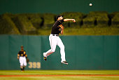Jordy Mercer of the Pittsburgh Pirates throws to first base in the third inning against the Milwaukee Brewers during the game at PNC Park on...