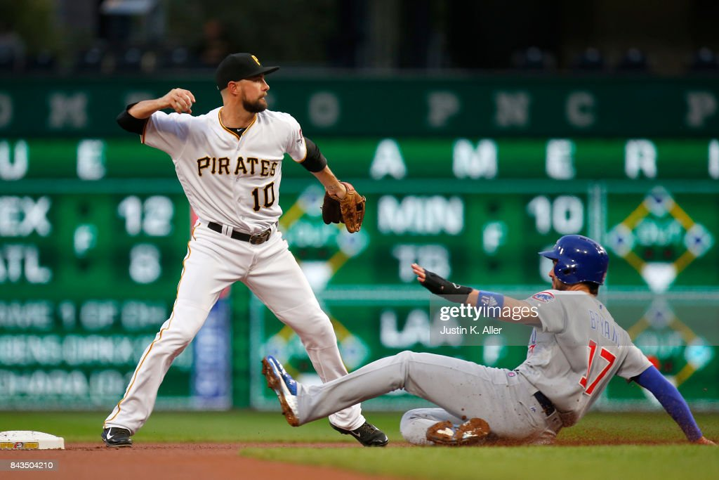 Jordy Mercer #10 of the Pittsburgh Pirates turns a double play in the first inning against Kris Bryant #17 of the Chicago Cubs at PNC Park on September 6, 2017 in Pittsburgh, Pennsylvania.