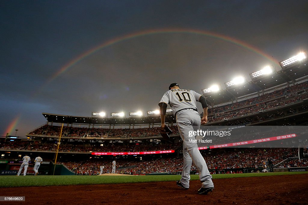 Jordy Mercer of the Pittsburgh Pirates walks onto the field under a rainbow in the first inning against the Washington Nationals at Nationals Park on...