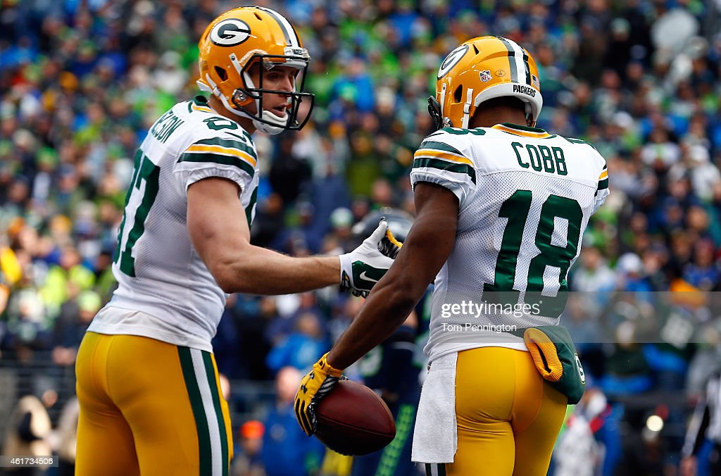 Jordy Nelson celebrates with Randall Cobb of the Green Bay Packers after Cobb catches a 13yard touchdown in the first quarter during the 2015 NFC...