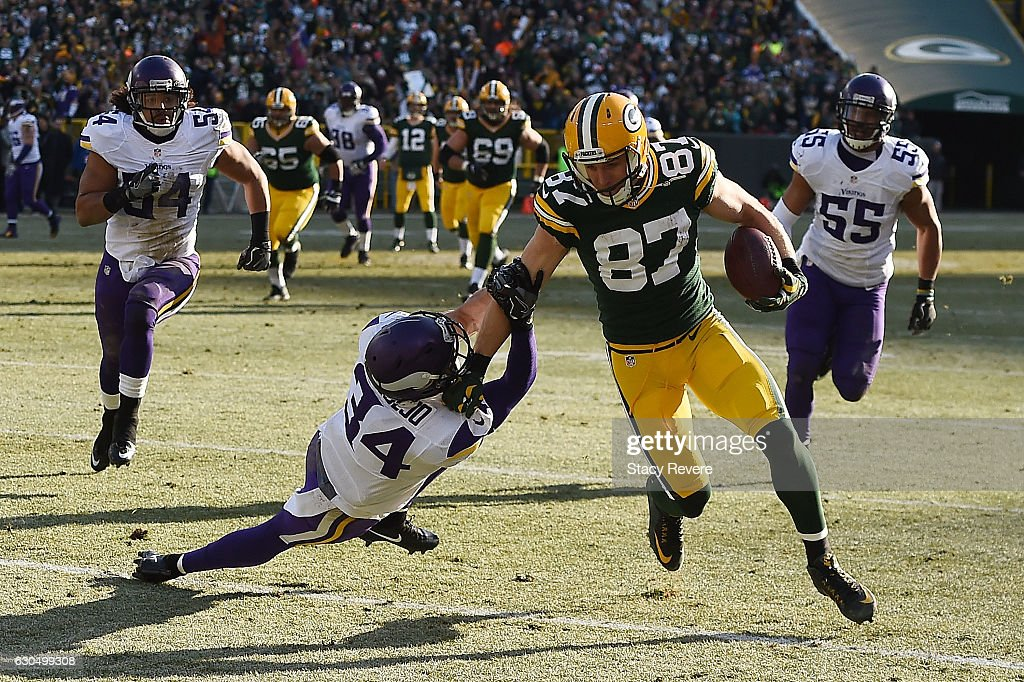Jordy Nelson #87 of the Green Bay Packers breaks a tackle by Andrew Sendejo #34 of the Minnesota Vikings during the second quarter of a game at Lambeau Field on December 24, 2016 in Green Bay, Wisconsin.