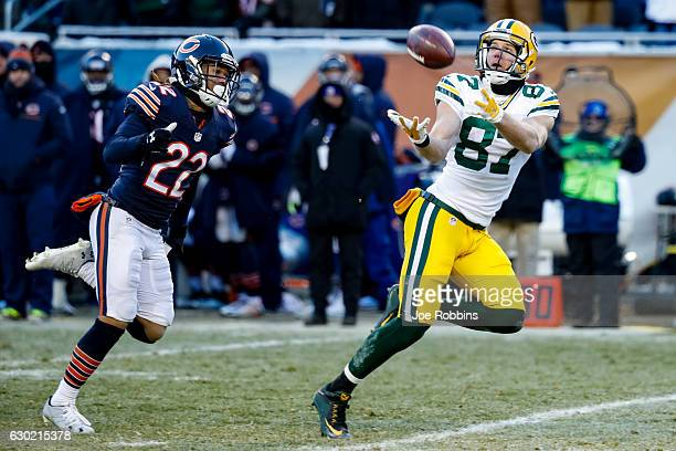 Jordy Nelson of the Green Bay Packers completes the pass for 60 yds ahead of Cre'von LeBlanc of the Chicago Bears in the fourth quarter at Soldier...