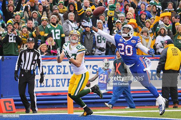 Jordy Nelson of the Green Bay Packers has a reception broken up by Corey Graham of the Buffalo Bills during the first half at Ralph Wilson Stadium on...