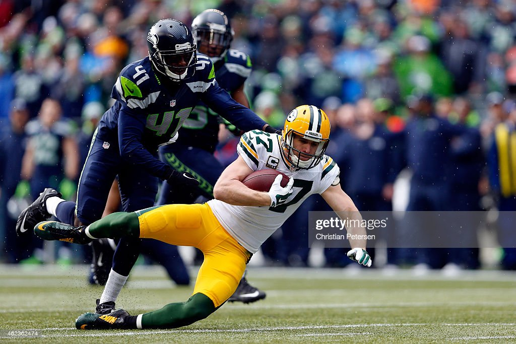 Jordy Nelson of the Green Bay Packers is tackled by Byron Maxwell of the Seattle Seahawks during the 2015 NFC Championship game at CenturyLink Field...
